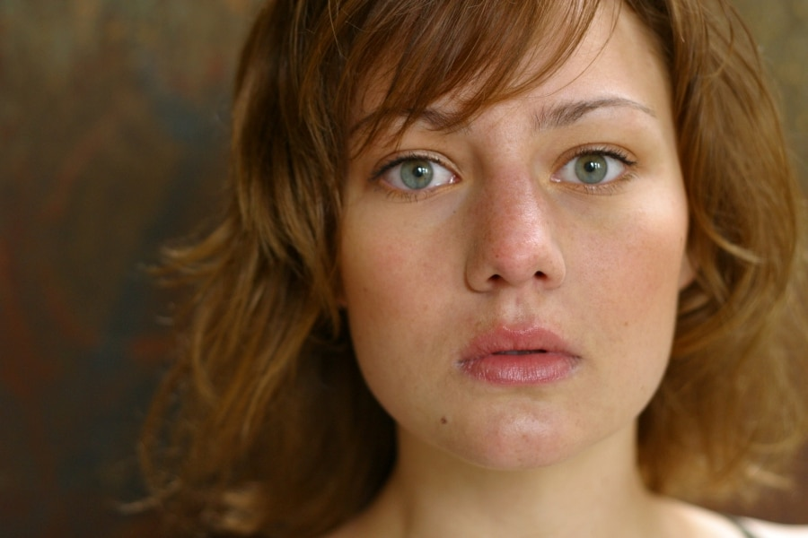 A woman with a blank facial expression
