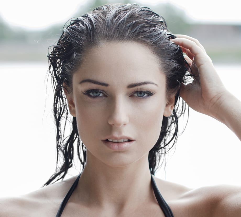 Woman with her hand in her wet hair