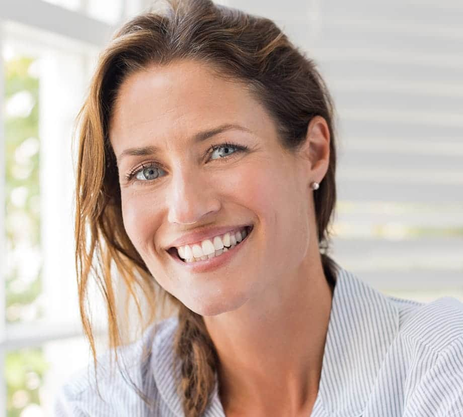 Woman with braided hair, smiling big