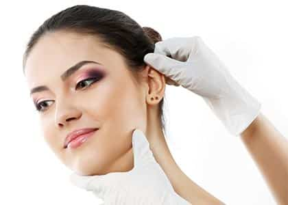 Beautiful young woman face with beauty treatment ear plastic